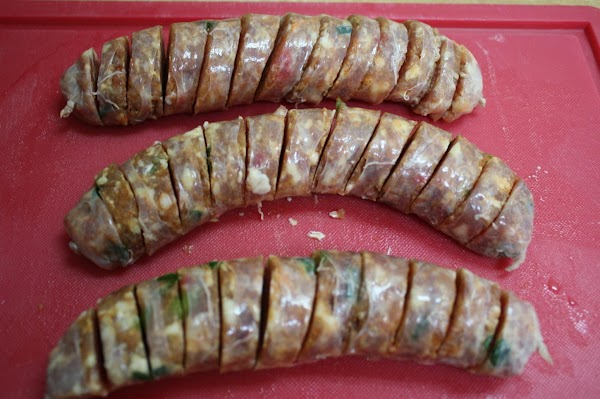 Slice frozen sausage into 1/2 inch pieces.  (It is much easier to slice...