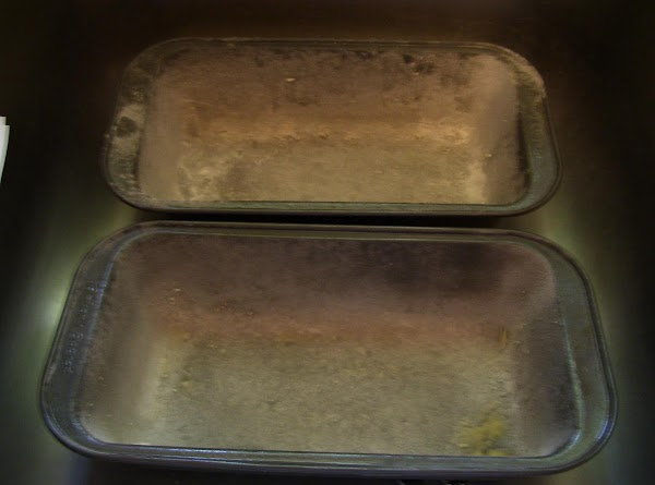 "Preheat oven @ 350.  Grease and flour two 8"" x 4"" pans."