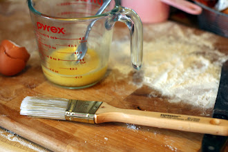 Photo: Make an egg wash. 2tbs of water plus one egg. Beat until well mixed. Steal one of your husband's unused paint brushes to brush on egg wash.