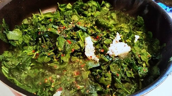 In a large skillet over medium heat, add oil, when hot add the spinach,...