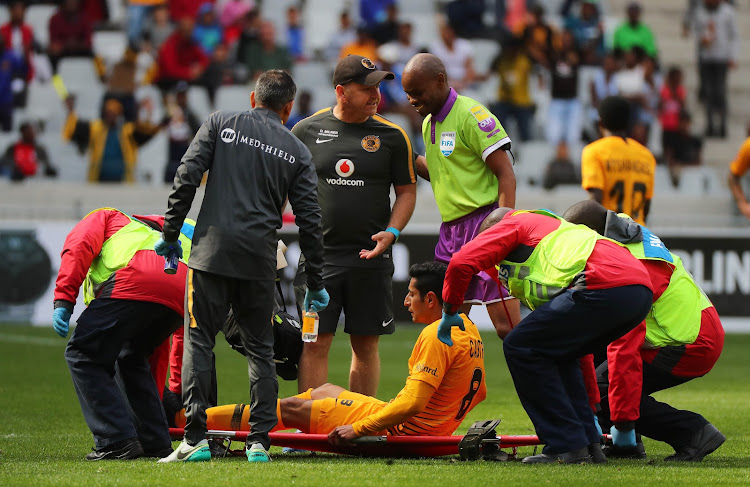 Kaizer Chiefs' striker Leonardo Castro lies on the ground injured during the Absa Premiership match against Cape Town City at Cape Town Stadium in Cape Town on September 15, 2018.