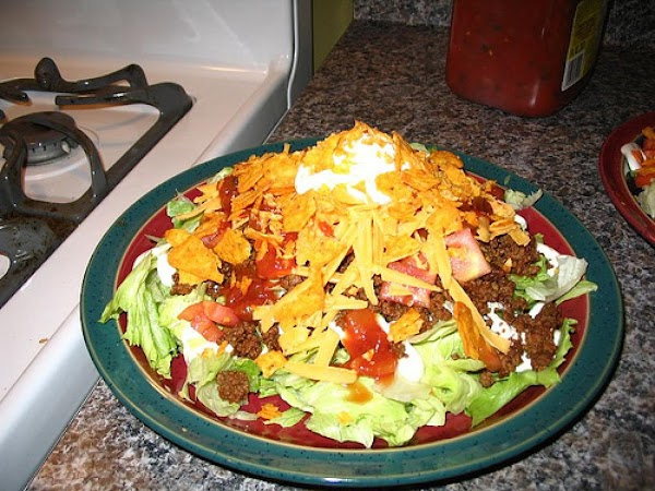 5. Add your toppings. Lettuce, tomato, sour cream, taco sauce, Doritos, or whatever you...