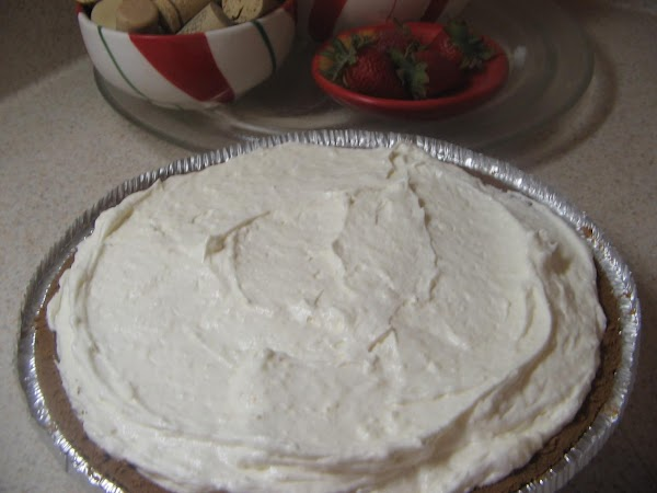 Fold in  half of the thawed  whipped topping; stir by hand to...