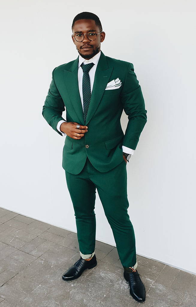 Siya Beyile wears: shirt and tie, suit and trousers, all The Threaded Man; shoes, Hugo Boss