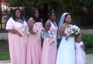 Photo: Tanesha with us bridesmaids, and her flower girl