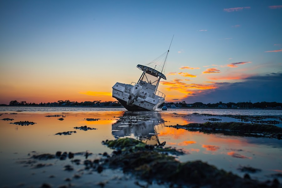 Stranded Boat in Clinton Harbor by Jim DeMicco - Landscapes Waterscapes ( water, reflection, sky, sunset, boat )