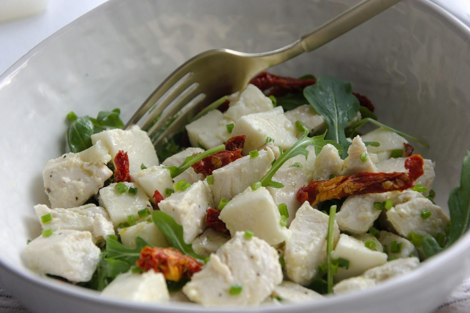 An example of clean eating - Mozzarella and chicken tossed with arugula, sun dried tomatoes and vinaigrette.