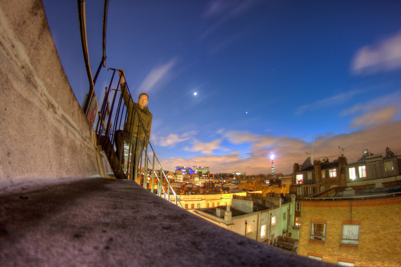 Photo: On Ur Rooftopz  Boy did I cringe writing that title.  I thought I would end the week with a fun image which I took earlier on this year. I only had my 500d and fisheye in the office so grabbed these after a few drinks in the local and headed upwards to get a view of the city from a pretty darn low angle.  It's hard to stand still for 30 seconds on a windy night, but I think it didn't come out too bad and dig the clouds rolling over me in the background.  I also thought I would end the week with the makings of a cold. I have a bit of a headache and can feel that something is attacking me; and as usual it ties in nicely with work trips coming up next week which really does suck. I often get a cold in the lead up to work travel…and have no idea why. I think the stress leading up to such things does something to my body.  Have a good weekend all.