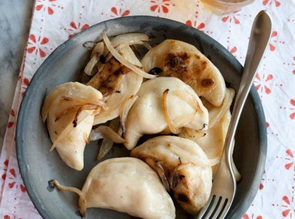Transfer pierogi to the pan with the onions. Heat on medium-high. Cook without moving...