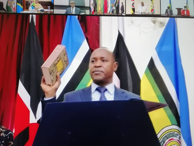 Incoming EAC Secretary General Peter Mathuki takes oath of office during the 21st EAC Summit.
