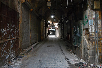 Photo: A visibly damaged and vandalized corridor of the al-Madina Souq located in the al-Jalloum district of the Old City in Aleppo, Syria. Many parts of the al-Madina Souq have been destroyed by intense fighting between Syrian rebel fighters and government forces. Aleppo, SYRIA - 11/4/2013. Credit: Ali Mustafa/SIPA Press