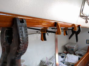 Photo: Re-installing salon trim.