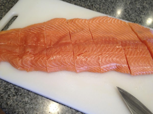 Take your Salmon fillets and slice them up into individual serving pieces.   Place...