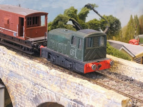 """Photo: 017 The standard gauge diesel loco that we saw on the bridge in the last photo. This is easily recognised as a Matchbox toy body and it has been mounted onto a Tenshodo """"Spud"""" chassis. At exhibitions, Tim often varies the standard gauge interest with a Terrier loco ."""