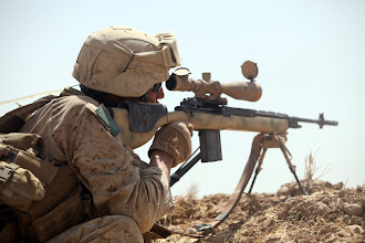 Photo: U.S. Marine Sgt. Zachary Zobrist, 3rd platoon, Bravo Company, 1st Reconnaissance Battalion, engages the enemy during a firefight in Northern Trek Nawa, Afghanistan, Aug. 15. The Marines and sailors of Company B are currently conducting counter insurgency operations in support of the International Security Assistance Force.