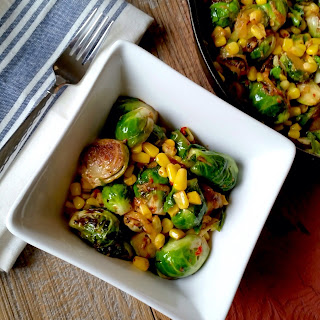 Spicy Pan-Seared Brussel Sprouts with Corn & Caramelized Onions.