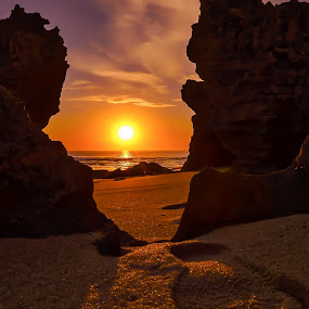 Between the rocks. by Keith Walmsley - Landscapes Sunsets & Sunrises ( clouds, sunset, beach, landscape, goldenhour )