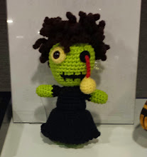 Photo: amigurumi zombie at the MLA conference bidding for good event. i so heart this! I've been wanting to learn how to crochet amigurumi.