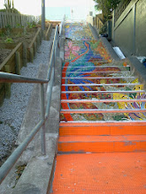 Photo: View of top five flights of steps of the Hidden Garden Steps (16th Avenue, between Kirkham and Lawton streets in San Francisco's Inner Sunset District) as KZ Tile workers finished installing more than 50 pieces of the 148-step ceramic-tile mosaic designed and created by project artists Aileen Barr and Colette Crutcher. For more information about this volunteer-driven community-based project supported by the San Francisco Parks Alliance, the San Francisco Department of Public Works Street Parks Program, and hundreds of individual donors, please visit our website at http://hiddengardensteps.org.