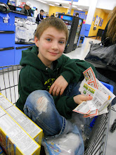 Photo: My oldest was in charge of matched coupons and he was happy to help.