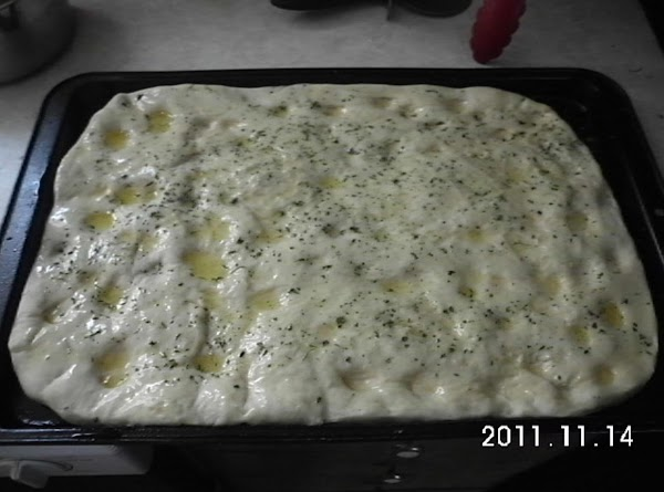 For dough:  Place wet ingredients into bread machine, add dry ingredients with yeast...