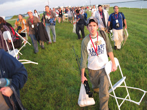 Photo: Carrying chairs to our seating area.