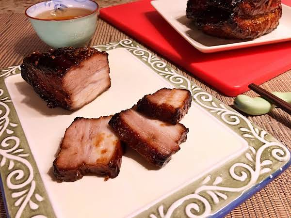 A Few Slices Of Pork On A Plate.