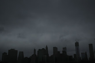 Photo: NEW YORK, NY - OCTOBER 29: Dark clouds are seen over the skyline of Manhattan as as Hurricane Sandy begins to affect the area on October 29, 2012 in New York City. The storm, which threatens 50 million people in the eastern third of the U.S., is expected to bring days of rain, high winds and possibly heavy snow. New York Governor Andrew Cuomo announced the closure of all New York City will  bus, subway and commuter rail service as of Sunday evening.  (Photo by Spencer Platt/Getty Images)