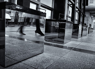 Photo: Best foot forward  While waiting at Tennozu Isle yesterday, I knelt down to try and shoot this row of reflective boxes. A lady walked by just as I pushed the shutter and I rather liked the effect (though I wish I could have caught the whole foot instead of missing the tip).  Time for me to get to bed - it's midnight, and I need to be at work tomorrow morning :(  Hopefully I can wrap things up in the office by noon and at least enjoy half of my Sunday! :)  Goodnight!  #creative366project