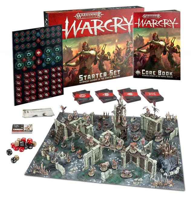 Warcry original starter set from 2019 - a wasteland board with a lot of stone and wood terrain, and two opposing warbands