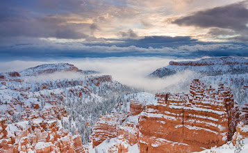 Photo: Fortress Bryce, Bryce Canyon National Park, UT#landscapephotography  #photographyworkflow  #photographytips BEST VIEWED LARGEMy favorite time to go to Bryce is in Winter? I love the combination of Red and White colors. We drove 3 hours (90 miles) in middle of a snow/sleet/rain to get to Bryce to photograph the sunrise. We made fresh track in about 12 inches of snow to get to the location and found near perfect conditions to photograph this gorgeous park.How was this image created?This image used our iHDR workflow an a soft GND filter to tame the light between the sky and the ground. The composition was selected to place the horizon using the rule of the thirds and the to showcase the magnificent valley covered in clouds.Enjoy & Share._____