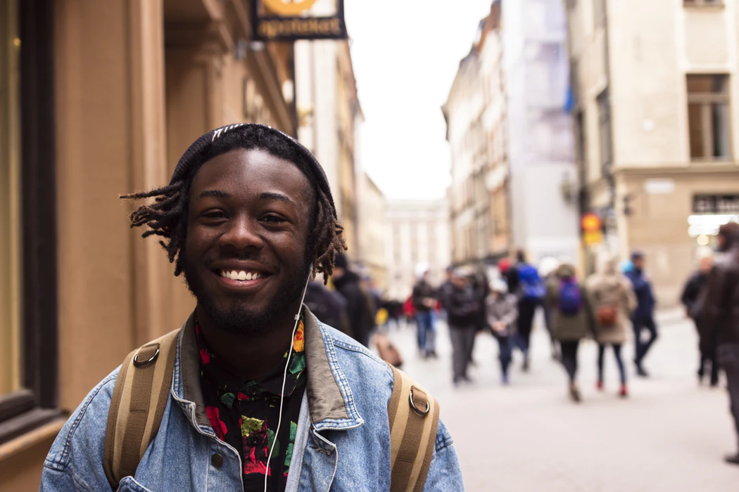 selective focus of man smiling near building