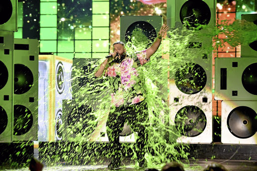 DJ Khaled gets slimed on stage at Nickelodeon's 2019 Kids' Choice Awards at Galen Center on Saturday in Los Angeles, California.