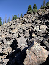 Photo: Traversing a talus slope and looking for the trail.