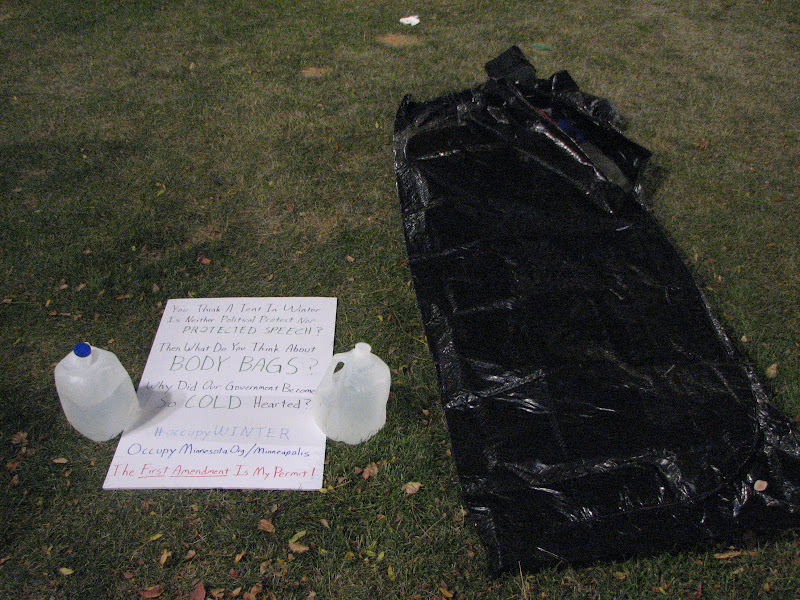 Photo: 2011 Nov 04. my body bag and poster on Friday night.  sleeping bag inside body bag was very warm, even in the cold wind.