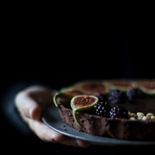 Tarte Au Chocolat With Figs, Blackberries And Pine Nuts.