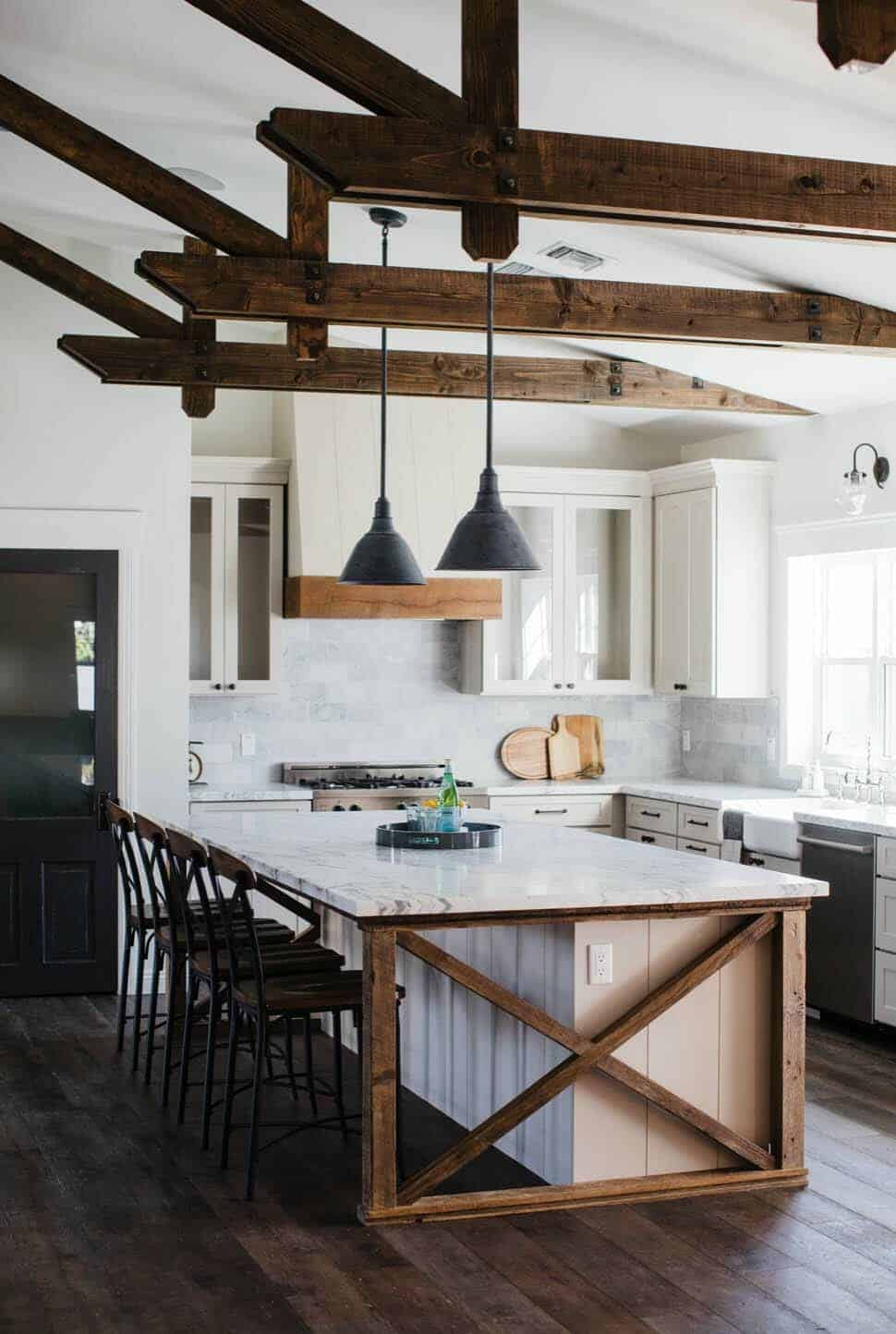modern farmhouse kitchen with white accents, x-base island and wood beams