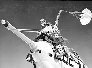 Photo: Captain L.J. Draayer, USMC, Rodeo clown and his assistant Ben W. Allen, AC2, taking a ride on a wild bronc (F9F-8B Cougar jet) in preparation for the Navy Relief Rodeo. April 15-16, 1959