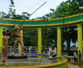 Photo: Statues of indigenous Amazonian family, Tena