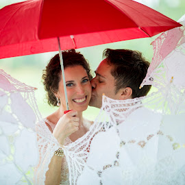 The Rain Didn't Get Them Down by John Wollwerth - Wedding Bride & Groom ( rainy wedding, wedding photography, beaufort wedding photographer, umbrella wedding, www.wollwerthimagery.com, http://www.wollwerthimagery.com, umbrella, bride and groom, south carolina wedding photographer )