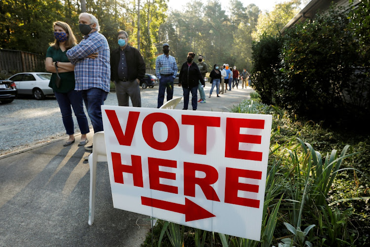 Voters wait in a 90-minute line to cast their ballots on the first day of the state's in-person early voting for the national elections in Durham, North Carolina. Picture: REUTERS/JONATHAN DRAKE