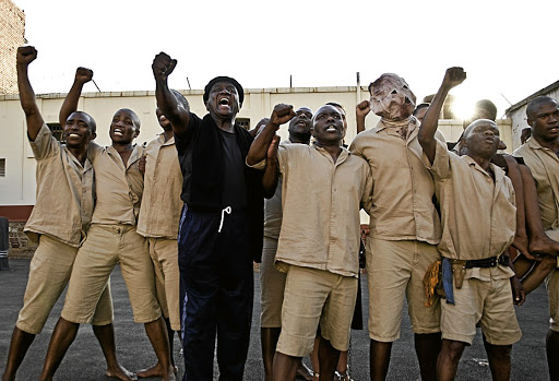 Screen scene: Bongani Ngema, centre, in black, plays the lead role in the film version of his 1980s play Asinamali. The writer and director says many of the themes in the production are relevant to today's younger generation and he hopes the work inspires and teaches future generations. Picture: SUPPLIED