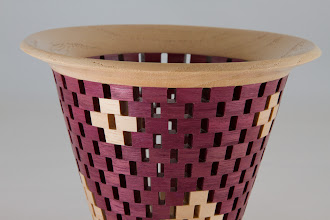 Photo: Detail of Bob's open segmented bowl.