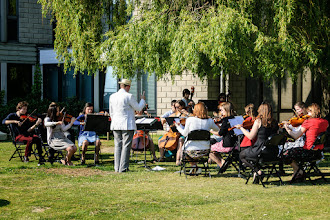 Photo: The String Sinfonia, conducted by Dan Harding, performing on campus on day four of Summer Music Week. Image: Ranjit Pender