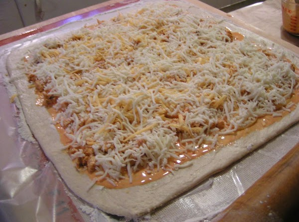 Place chicken pieces evenly over top and then sprinkle with cheese.