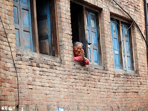 """Photo: This woman is giving us the typical Nepalese greeting of """"Namaste"""" in Bhaktapur."""