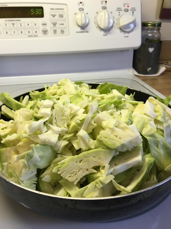 Add your chopped cabbage to the skillet (don't worry about how full it is,...