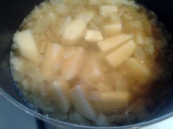 Place quartered potatoes & garlic into pot and barely cover with water. Bring to...