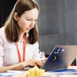 Woman working on her laptop.