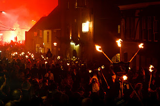 Photo: Here's another one from the Rye Bonfire Night for +Grayson Hartman's #FireFriday. This time it's a photo of the procession of torch carriers that walked through the town.  The intense red glow that's lighting up the whole sky in the distance is caused by a burning flare. I'll post a photo of the flare and the person carrying it shortly!